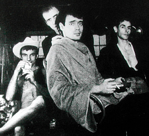 "Freddie Herko (in cowboy hat), Billy Name,  John Daley and James Waring in Warhol's ""Haircut #1"""